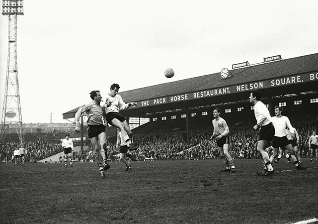 John Hulme rising for a header